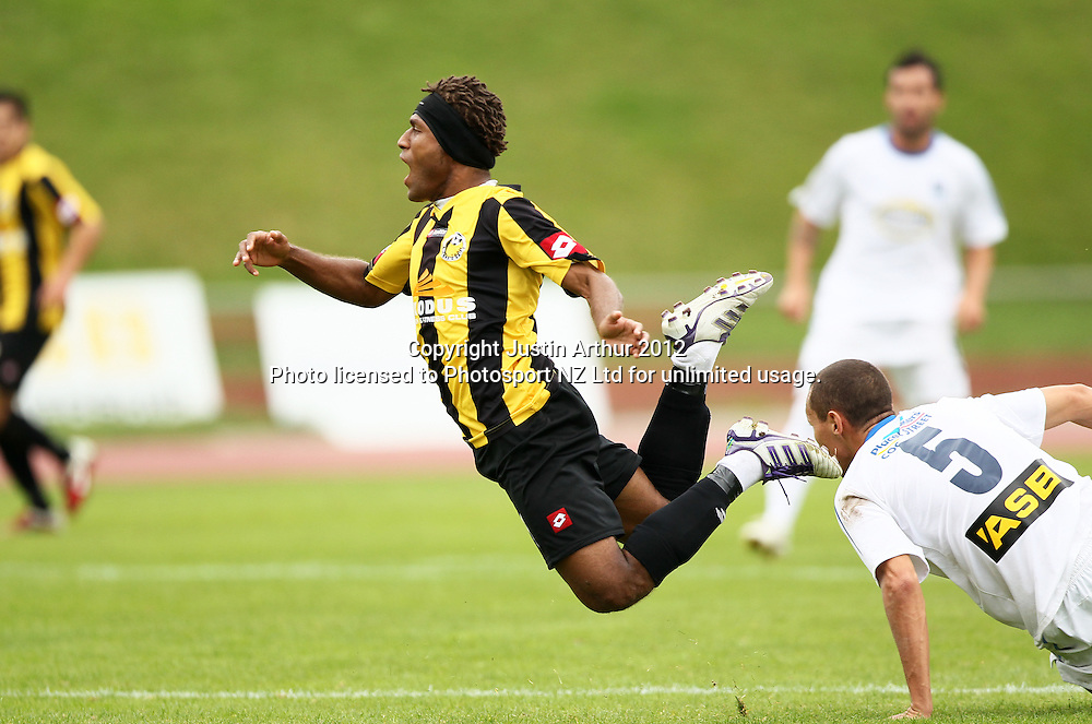 Wellington's Henry Fa'arodo goes flying over Auckland's Angel Berlangaw. ASB Premiership Football Semifinal - Team Wellington v Auckland City at Newtown Park, Wellington, New Zealand on Sunday 15 April 2012. Photo: Justin Arthur / Photosport.co.nz