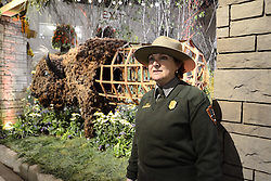 Parker ranger CLAIR COMER, stationed at the Shenandoah National Park in Virginia greeting visitors as she stand next to  American Bison/Prairie House, 2011 by Emily White, at the entrance of the 2016 PHS Flower Show.  'Explore America' is the them for the 2016 edition of the Pennsylvania Horticulture Society Flower Show. The annual show is held at the Pennsylvania Convention Center in Center City Philadelphia PA., and rubs till March 13.