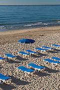 Rows of beach chairs in Benidorm beach, Benidorm, Alicante province Spain,Europe