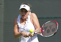 LONDON, ENGLAND - Tuesday, June 21, 2011: Caroline Wozniacki (DEN) in action during the Ladies' Singles 1st Round match on day two of the Wimbledon Lawn Tennis Championships at the All England Lawn Tennis and Croquet Club. (Pic by David Rawcliffe/Propaganda)
