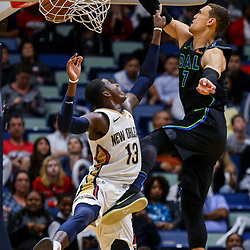 Mar 20, 2018; New Orleans, LA, USA; Dallas Mavericks center Dwight Powell (7) dunks over New Orleans Pelicans forward Cheick Diallo (13) during the second half at the Smoothie King Center. Pelicans defeated the Mavericks 115-105. Mandatory Credit: Derick E. Hingle-USA TODAY Sports