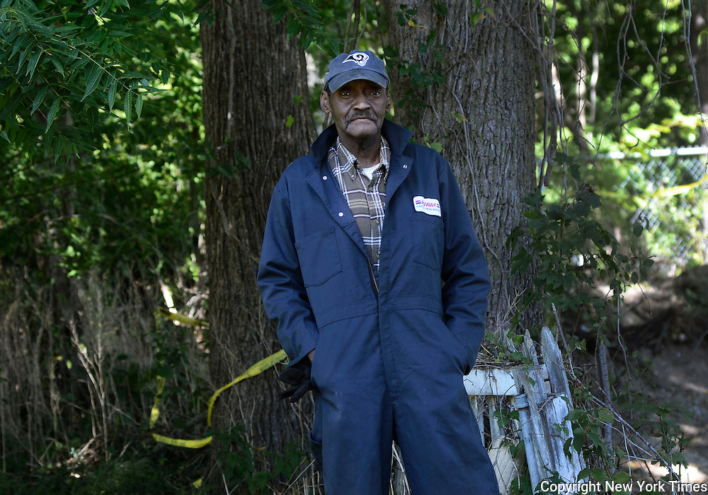 Joseph Crawford, 71, stands on the property of his life-long home in Auburn, NY, Thursday, September 15, 2016. Crawford lives next-door to a where inmate remains were discovered in his neighbor's backyard in July. The remains were buried more than a century ago and the state Department of Corrections has pledged to move them to a prison cemetery. Crawford said he also found remains when he played in his backyard in the 1950's. <br /> (Heather Ainsworth for The New York Times)