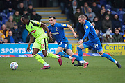 AFC Wimbledon defender Luke O'Neill (2) and AFC Wimbledon attacker Shane McLoughlin (19) chasing Bolton Wanderers attacker Joe Dodoo (23) during the EFL Sky Bet League 1 match between AFC Wimbledon and Bolton Wanderers at the Cherry Red Records Stadium, Kingston, England on 7 March 2020.