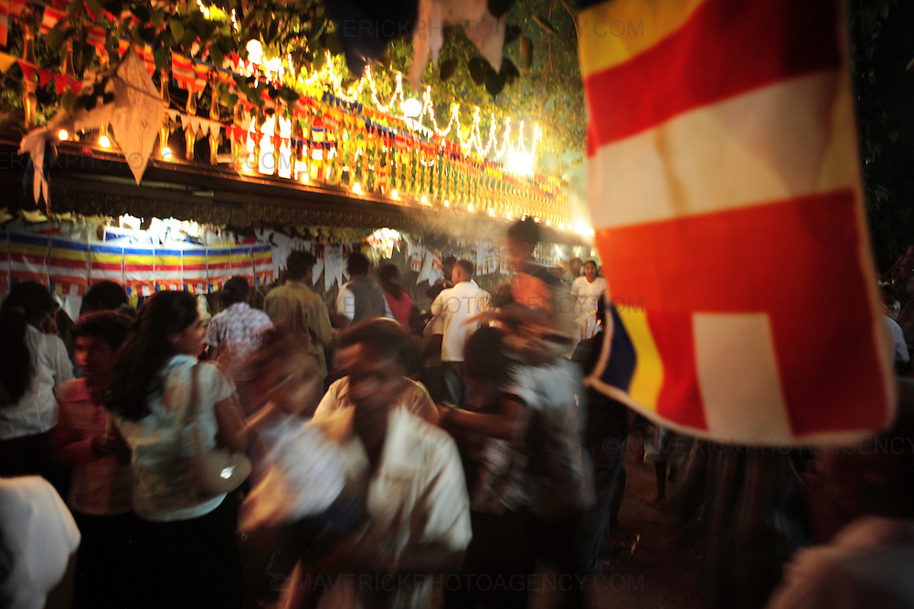 Crowds of devotees gather for evening Vesak rituals at Kelaniya temple, Colombo Sri Lanka...Vesak is the most significant period in the Buddhist calendar. It celebrates the birth, enlightenment, and death of the Buddha..