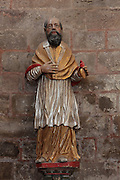 Statue of St Francois de Sales, 1567-1623, bishop and Doctor of the Church, in the Abbatiale Sainte-Foy de Conques or Abbey-church of Saint-Foy, Conques, Aveyron, Midi-Pyrenees, France, a Romanesque abbey church begun 1050 under abbot Odolric to house the remains of St Foy, a 4th century female martyr. The church is on the pilgrimage route to Santiago da Compostela, and is listed as a historic monument and a UNESCO World Heritage Site. Picture by Manuel Cohen
