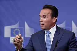 59895737<br /> U.S. actor and former Governor of California Arnold Schwarzenegger attends a press conference with European Commission President Jose Manuel Barroso (not seen) after their meeting at the European Union headquarters in Brussels, capital of Belgium, on June 24, 2013. They talked about climate change during their meeting on Monday  June 24, 2013. Picture by imago / i-Images<br /> UK ONLY