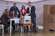 Bogota, Cundinamarca, Colombia - 02.10.2016        <br /> <br /> The Colombian President Santos at his vote for peace with the FARC. Peace contract referendum in Colombia. The Colombian citizens voting if the peace treaty negotiated between the government and the left FARC guerrilla becomes valid. The FARC has been in war with the Colombian government for 52 years.<br />  <br /> Der kolumbianische Praesident Santos bei seiner Stimmabgabe f&uuml;r den Frieden mit der FARC. Friedensvertrags Referendum in Kolumbien. Die kolumbianische Bev&ouml;lkerung stimmt dar&uuml;ber ab ob der ausgehandelte Friedensvertrag zwischen der Regierung und der linken FARC Guerilla gueltig wird. Die FARC befindet sich seit 52-Jahren im Krieg mit der kolumbianschen Regierung. <br /> <br /> Photo: Bjoern Kietzmann