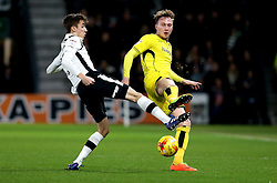 Cauley Woodrow of Burton Albion tackles Julien de Sart of Derby County - Mandatory by-line: Robbie Stephenson/JMP - 21/02/2017 - FOOTBALL - iPro Stadium - Derby, England - Derby County v Burton Albion - Sky Bet Championship