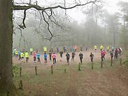 Nederland, Vught, 20140412.<br /> Warming up in het bos bij Vught. <br /> De nevel hangt nog tussen de bomen op deze vroege lente ochtend.<br /> Hardlopers in felgekleurde kleding staan in een cirkel en doen oefeningen.<br /> Start-to-Run in Vught bij Loopschool Wim Akkermans<br /> <br /> Netherlands, Vught, 20,140,412. <br /> Warming up in the woods near Vught. <br /> The mist still hangs between the trees on this early spring morning. <br /> Runners in brightly colored clothes stand in a circle and doing exercises. <br /> Start-to-Run in Vught at Running School Wim Akkermans