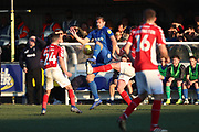 AFC Wimbledon striker James Hanson (18) battles for possession with Charlton Athletic defender Patrick Bauer (5) during the EFL Sky Bet League 1 match between AFC Wimbledon and Charlton Athletic at the Cherry Red Records Stadium, Kingston, England on 23 February 2019.