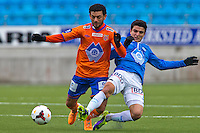 Treningskamp fotball 2014: Molde - Aalesund.  Aalesunds Michael Barrantes Rojas (t.v.) felles av Mohamed Elyounoussi i treningskampen mellom Molde og Aalesund på Aker stadion.
