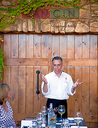 Dan Marca, co-owner with his wife Cindy of Dancin Vineyards, Medford, Oregon, explains his wine making concepts during a luncheon at the vineyard's restaurant.
