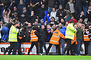 Police and stewards have to hold back celebrating Newcastle fans who invaded the pitch after the injury time equaliser scored by Matt Ritchie (11) of Newcastle United during the Premier League match between Bournemouth and Newcastle United at the Vitality Stadium, Bournemouth, England on 16 March 2019.