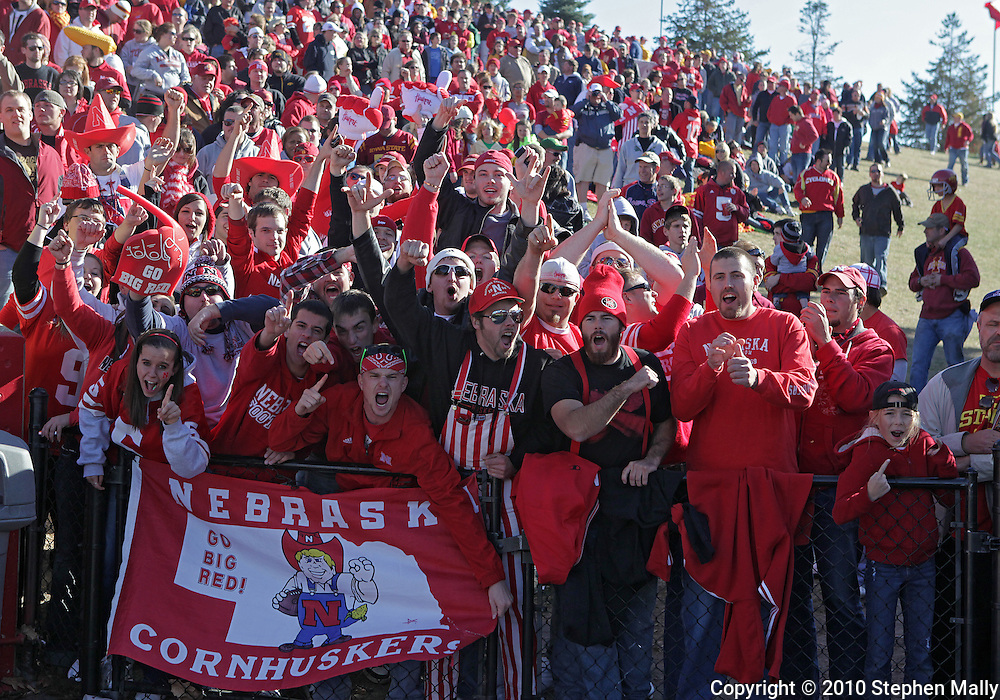 November 06 2010: Nebraska fans cheer during the first half of the NCAA football game between the Nebraska Cornhuskers and the Iowa State Cyclones at Jack Trice Stadium in Ames, Iowa on Saturday November 6, 2010. Nebraska defeated Iowa State 31-30.