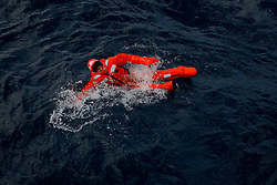 ATLANTIC OCEAN ABOARD ARCTIC SUNRISE 21MAY11.. -  Greenpeace activists during swim training in survival suits in the north Atlantic...Photo by Jiri Rezac / Greenpeace