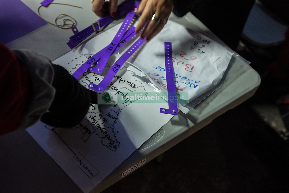 October 25, 2016 - Calais, France - Migrants show on the map at the registration center near the Calais Jungle  in Calais, France, on 25 October 2016 on the map where they want to be distributed. Up to the evening, about 4,000 migrants from the Refugee camp on the coast at the English Channel were distributed to several regions in France. The police have begun to tear down the huts and tents in the camp. (Credit Image: © Markus Heine/NurPhoto via ZUMA Press)
