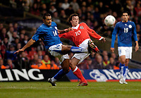 Photo: Leigh Quinnell.<br /> Wales v Paraguay. International Friendly. 01/03/2006. Wales' Simon Davies challenges Paraguays Paulo Da Silva.