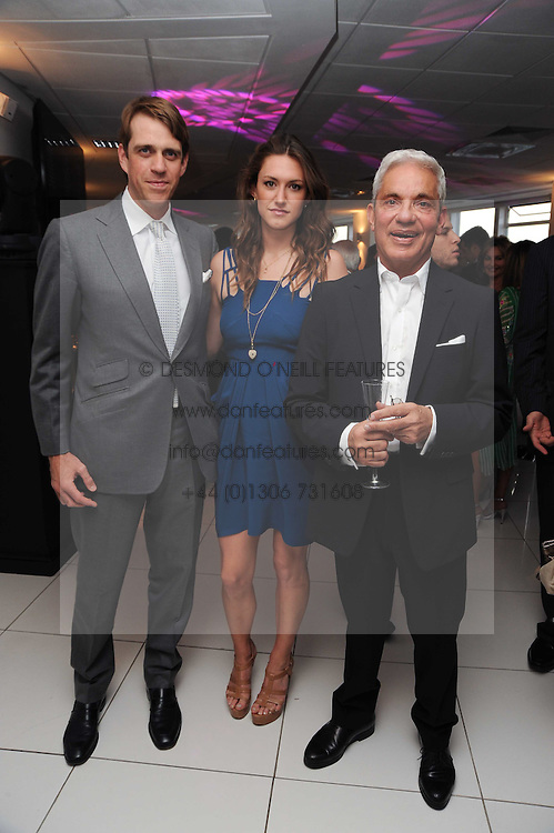 Left to right, BEN ELLIOT, MARY-CLARE WINWOOD and SIMON REUBEN at The Reuben Foundation and Virgin Unite Haiti Fundraising dinner held at Altitude 360 in Millbank Tower, London on 26th May 2010.