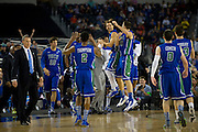 The Florida Gulf Coast University Eagles celebrate during a timeout against the University of Florida Gators during the NCAA South Regionals at Cowboys Stadium in Arlington on Friday, March 29, 2013. (Cooper Neill/The Dallas Morning News)