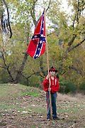 Arkansas, AR, USA, Old Washington State Park, Civil War Weekend. Pride of the South. Young boy holding the flag before battle