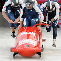 28 February 2007:    The Italy 1 bobsled driven by Simone Bertazzo with sidepushers Danilo Santarsiero and Sergio Riva, and brakeman  Samuele Romanini jump into the sled at the start of the 2nd run at the 4-Man World Championships competition on February 27 at the Olympic Sports Complex in Lake Placid, NY.