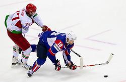 Alexander Kitarov of Belarus vs Gregory Kuznik of Slovenia during ice-hockey match between Slovenia and Belarus of Group G in Relegation Round of IIHF 2011 World Championship Slovakia, on May 8, 2011 in Orange Arena, Bratislava, Slovakia.  (Photo By Vid Ponikvar / Sportida.com)