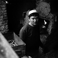Rosajim, a master blacksmith at his forge at Katman Bazaar. Katman Bazaar is a small block located in the Old city of Kashgar in the Xinjiang province of China. The Uyghur blacksmiths have worked in these quarters for hundreds of years. Like most parts of the ancient Kashgar, Katman Bazaar is now under constant danger of being demolished for the sake of urban development supported by the Chinese government.