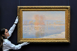 "© Licensed to London News Pictures. 06/10/2017. London, UK. A technician presents ""Les Glaçons, Bennecourt"", 1893, by Claude Monet at a preview at Sotheby's in New Bond Street of contemporary, impressionist and modern art works to be auctioned in New York in November 2017 Photo credit : Stephen Chung/LNP"