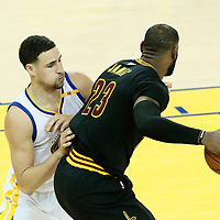 12 June 2017: Cleveland Cavaliers forward LeBron James (23) posts up Golden State Warriors guard Klay Thompson (11) during the Golden State Warriors 129-120 victory over the Cleveland Cavaliers, in game 5 of the 2017 NBA Finals, at the Oracle Arena, Oakland, California, USA.