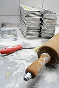 Baker work table with rolling pin, flour and baking tins