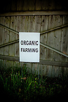 Farming in Oregon and Washington.  A sign saying Organic Farming on an old fence.