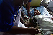 Kadie Josiah, 16, lies in bed as she recovers after a c-section surgery that saved her and her child at the UBC hospital in the town of Mattru Jong, Sierra Leone, on Thursday April 22, 2010. It was her first pregnancy, and she lives 15 kilometers away from the hospital.