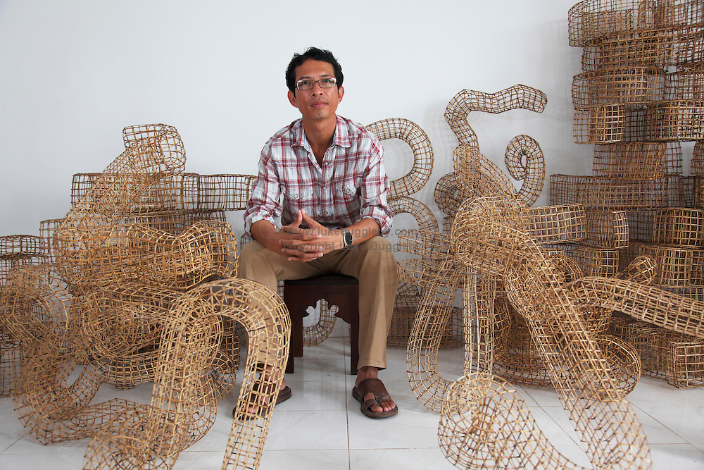 Cambodian artist Sopheap Pich at his studio in Phnom Penh. He uses rattan and bambo to create sculptures representing various aspects of Khmer life. Sopheap grew up in Massachusetts, USA, before returning to Phnom Penh several years ago to continue his artist career. He is now one of the most successful Cambodian artists of his generation having been exhibited in solo shows in New York, Bangkok, Hong Kong, Singapore and Dubai..