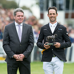 Jonathan Paget receives a third place Mitsubishi Motors Trophy from Lance Bradley, Managing Director of Mitsubishi Motors UK  <br /> Mitsubishi Motors Badminton Horse Trials - Badminton 2015<br /> © Hippo Foto - Jon Stroud