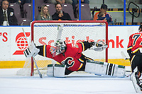 PENTICTON, CANADA - SEPTEMBER 17: Tyler Parsons #82 of Calgary Flames deflects a shot by the Edmonton Oilers on September 17, 2016 at the South Okanagan Event Centre in Penticton, British Columbia, Canada.  (Photo by Marissa Baecker/Shoot the Breeze)  *** Local Caption *** Tyler Parsons;