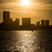 Boston skyline sunset picture with Boston Harbor and Boston skyscrapers
