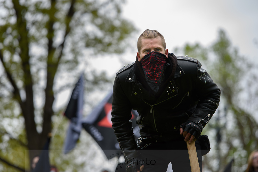 A member of North Shore Antifa (short for antifacist) watches factions of the alt-right rally on Boston Common, May 13, 2017.<br /> Photo / Kate Flock