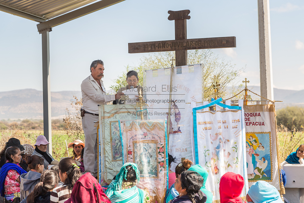 Indigenous pilgrims gather for outdoor mass on the pilgrimage route to the Sanctuary of Atotonilco an important Catholic shrine in Atotonilco, Mexico.