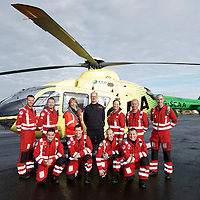 FREE TO USE PHOTOGRAPH....30.10.15<br /> Scotland's Charity Air Ambulance (SCAA) unveiled it's new helicopter at Perth airport this morning a EC135 T2i (pictured) which replaces the Bolkow 105 helicopter which is retiring from service. The new helicopter will increase speed, range, endurance and payload, allow SCAA to fly at night and in cloud. Pictured from left, Mark Tynan, Craig McDonald, Maureen Young, Chief Pilot Russell Myles, Julia Barnes, John Salmond and Lead Paramedic John Pritchard.<br /> Front row from left, Paul Gowans, Phillip Campbell, Alan Finlayson and Chris Darlington<br /> for further info please contact Maureen Young on 07778 779000<br /> Picture by Graeme Hart.<br /> Copyright Perthshire Picture Agency<br /> Tel: 01738 623350  Mobile: 07990 594431