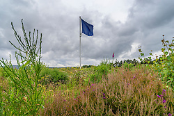 Flag indicating frontline of the Jacobite army on moorland at Culloden Moor former battlefield in Highland, Scotland