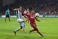 23.10.12. Copenhagen, Denmark. UEFA Champions League Group E, FC Nordsjaelland  1 vs Juventus 1 at the Parken Stadium. Mtiliga (L) of FC Nordsjaelland fights for the ball during the UEFA Champions League. Photo: © Ricardo Ramirez..