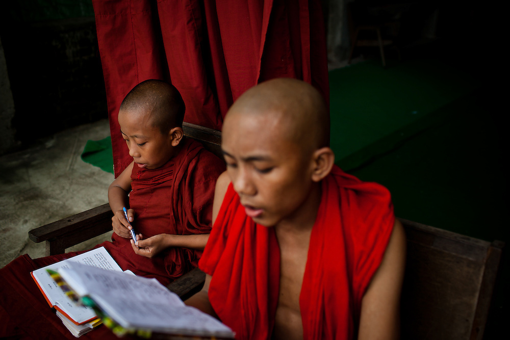 Several young monks get a head start on their studies before joining the rest of the congragation.