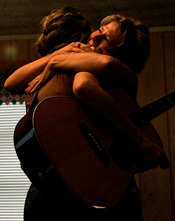 Lorry Venetta, right, tears running down her face, rushes to hug sister Carrie Byrd after Carrie's final performance at Carolina Cowboy Church.