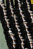 Navy Midshipmen March on before the Army-Navy Football game on Dec. 10, 2011.  (Alan Lessig/Staff)