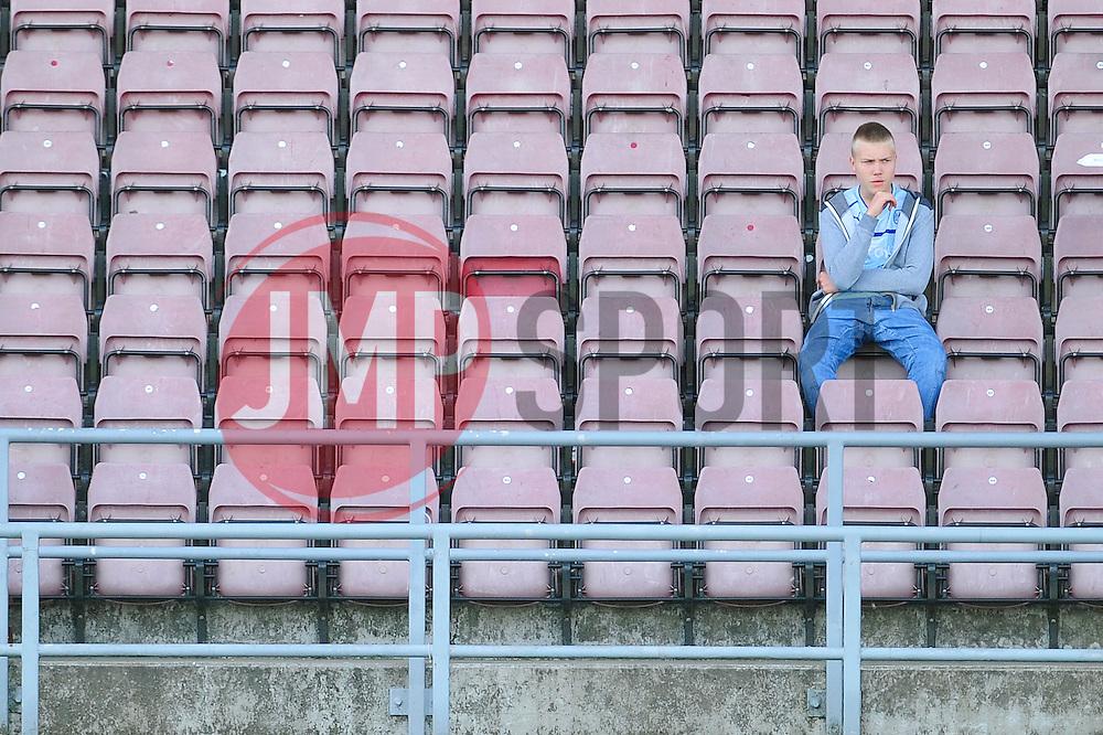 A Coventry City fan sits alone at the Sixfields Stadium  - Photo mandatory by-line: Dougie Allward/JMP - Tel: Mobile: 07966 386802 11/08/2013 - SPORT - FOOTBALL - Sixfields Stadium - Sixfields Stadium -  Coventry V Bristol City - Sky Bet League One