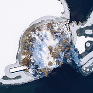 http://Duncan.co/small-island-with-snow-from-above