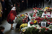 Mourners gather at the funeral of Russian journalist Anna Politkovskaya, murdered in Moscow on 7 October, 2006. She was shot four times, once in the head, in an elevator in her apartment block. .The funeral, held in the Troyekurovskoye cemetery in western Moscow, was conducted by an Orthodox priest. Before the burial, thousands of well-wishers filed passed her body..Known for her critical coverage of the war in Chechnya and of Russian President Vladimir Putin, her murder is widely believed to be connected to her investigative work..The 48-year-old was a tireless reporter who had written a critical book on Russian President Vladimir Putin and his campaign in Chechnya, documenting widespread abuse of civilians by government troops..She leaves behind a son, a daughter and an ex-husband.