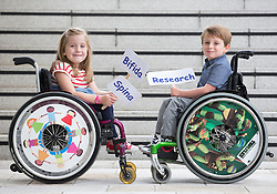 Repro Free: 03/09/2014<br /> Emily Fitzsimons (7) from Kildare and Sean Nelson (6) from Sallins Co Kildare are pictured at the launch of the Temple Street national Spina Bifida services research report. This report shows the gross under-resourcing of services for children with Spina Bifida both in Temple Street and across the country. These children have extremely complex needs but the research showed that 54% of them do not have access to a multidisciplinary team (MDT) clinic despite the fact that 69% of children with SB over three years use a wheelchair, 93% of them over five years require continence support and 64% of them have a VP shunt to manage hydrocephalus. Picture Andres Poveda