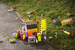 © Licensed to London News Pictures . 05/11/2015 . Salford , UK . Fireworks left unattended on a pavement on Graythorpe Walk . Manchester Fire reports receiving more than 300 calls in less than 7 hours, from 4.30pm, including to buildings, cars and wheelie bins set alight by arsonists . At some calls fire crews were subject to vandalism , including a hose being sliced whilst it was being used to fight a fire in Leigh and bricks being thrown at crews attending a job in Miles Platting . Fire crews deal with arson attacks across Greater Manchester during Bonfire Night . Photo credit : Joel Goodman/LNP