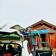 Claude loading the skis into the ski box at the Airbnb in Akureyri, Iceland